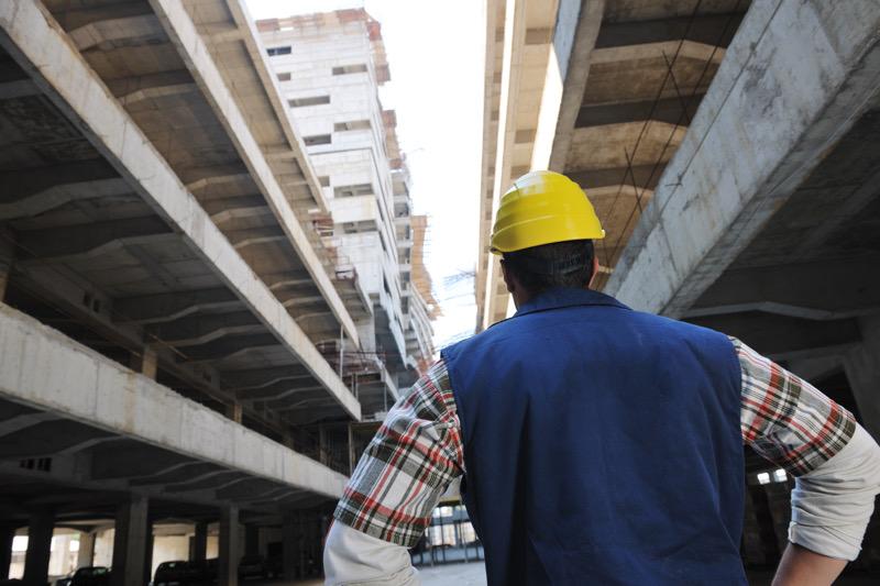 Hardhat worker on bridge construction site.